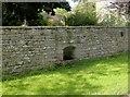 NZ0551 : Trough in garden wall by Robert Graham