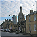 TL5380 : Ely: almshouses, tower and spire by John Sutton