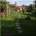 TG2536 : Stepping stones through a north Norfolk coastal garden in the making by D Gore