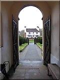 TQ0044 : Holy Trinity, Bramley: path by Basher Eyre