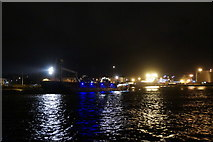 NJ9505 : Ship leaving Aberdeen Harbour at night, from Footdee by Mike Pennington