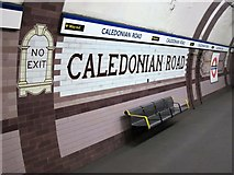 TQ3084 : Caledonian Road tube station - ceramic tiles (southbound platform) by Mike Quinn