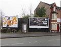 SJ7055 : BT phonebox between advertising hoards, Edleston Road, Crewe by Jaggery