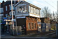 TQ3891 : Former signal box by level crossing at Highams Park by David Martin