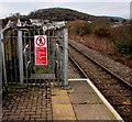 SS8689 : Warning notice at the NW end of Garth railway station by Jaggery