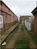 SZ0894 : Winton: concrete slope on footpath L01 by Chris Downer