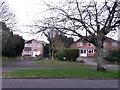 SZ0695 : West Howe: looking across Moorside Road towards footpath U38 by Chris Downer