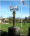 TM0288 : The Quidenham village sign by Evelyn Simak