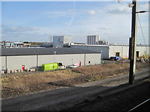 TL2373 : View from a Peterborough-London train - Silos on an industrial estate, Huntingdon by Nigel Thompson