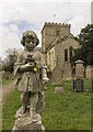 TA1181 : Graveyard statue, St Oswald's church, Filey by J.Hannan-Briggs