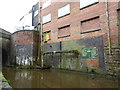 SJ8762 : Advertising alongside the Macclesfield Canal by Jonathan Hutchins