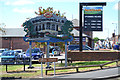 SK0405 : Town sign and shop sign by Silver Street, Brownhills by Robin Stott