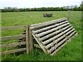 SP9080 : Wooden fence and sheep pasture east of Warkton by Richard Humphrey
