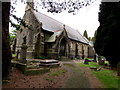 ST2688 : Entrance to St John the Baptist church, Rogerstone, Newport by Jaggery
