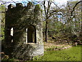 SK5313 : Small folly next to a flooded quarry by Mat Fascione