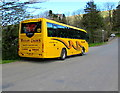 SN9347 : Yellow coach parked in Llangammarch Wells by Jaggery