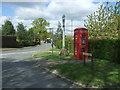 TL9159 : Bus stop and telephone box, Hollybush Corner by JThomas