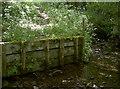 ST6565 : Wooden embankment by Neil Owen
