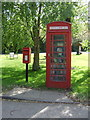 TM1125 : Elizabeth II postbox and telephone box on Manningtree Road, Little Bentley by JThomas