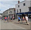 SO8505 : Half marathon runners descend High Street Stroud by Jaggery