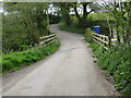 SW9048 : Ladock Road crossing a bridge over a small stream by Peter Wood