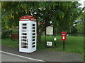 TF6801 : Elizabeth II postbox and telephone box on the village green, Wereham by JThomas