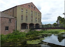 TA2609 : Derelict warehouse next to the River Freshney by Mat Fascione