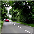 SP0000 : Red car at the back of a queue on the A429 near Cirencester by Jaggery