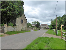 ST6822 : Road past Stowell church and farm by Robin Webster