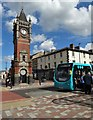 NZ6025 : Edwardian clock tower and bus stop in Redcar town centre by Neil Theasby