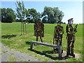 TQ5492 : Figures in Central Park, Harold Hill by Marathon