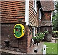 TQ7817 : Defibrillator on 15th C pub wall, Sedlescombe Green by Patrick Roper