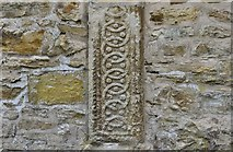 SP1106 : Bibury, St. Mary's Church: Saxon gravestone set into the north wall of the chancel by Michael Garlick