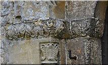 SP1106 : Bibury, St. Mary's Church: The Norman north door with palm leaf design on the capitals by Michael Garlick