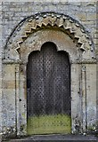 SP1106 : Bibury, St. Mary's Church: The Norman north door (ca1180) with unusual tympanum by Michael Garlick