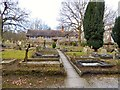 SJ9689 : St Martin's graveyard and former school by Gerald England