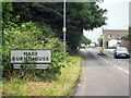 SW7634 : Mabe Burnthouse Village Sign by Roy Hughes