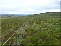 SH9319 : Fenceline below Mynydd Coch by Richard Law
