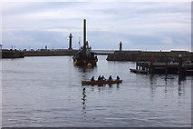 NZ8911 : Whitby harbour, rowers and dredger by Robert Eva