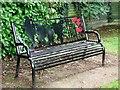 TG2701 : New memorial seat in Poringland's Memorial Garden by Evelyn Simak