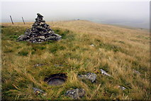 SD7695 : Trig point and cairn on Swarth Fell Pike by Roger Templeman