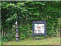 NY4632 : Cycle milepost and community noticeboard, Laithes by Rose and Trev Clough