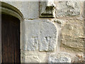 NU1019 : St Maurice, Eglingham - carved initials by Stephen Craven