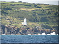 SW4422 : Waves  breaking  on  the  rocks  below  Tater-du  lighthouse by Martin Dawes