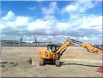 TQ7769 : Digger at Chatham Docks by David Anstiss