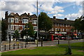 TQ3093 : Southgate Green: shops along Cannon Hill by Christopher Hilton