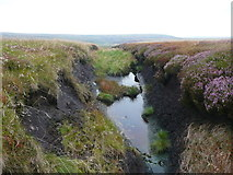 SE0504 : Land drainage channel on the moor, Saddleworth by Humphrey Bolton