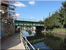 TQ2282 : West London Line bridge over the Grand Union Canal by Gareth James