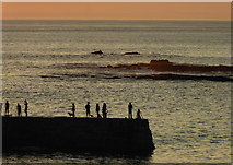SW3526 : Figures on the breakwater in the evening light by Rod Allday