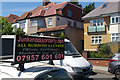 TQ2389 : Houses and advertisement on Finchley Lane, Hendon by Christopher Hilton